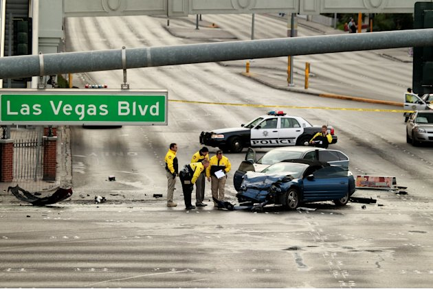 Law enforcement personal investigate the scene of a mulit-vehicle accident on Las Vegas Blvd and Flamingo Road Thursday, Feb. 21, 2013. Authorities say a Range Rover opened fire on a Maserati at a sto