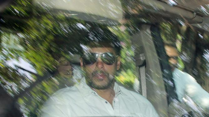 Bollywood actor Salman Khan arrives at a court in Mumbai, India, Wednesday, May 6, 2015. Media reports say a Mumbai court has held Khan guilty of running over five men sleeping on a sidewalk, killing one in a 2002 hit-and-run case. The court on Wednesday charged Khan with culpable homicide, saying all charges against him had been proved, Press Trust of India said. (AP Photo)