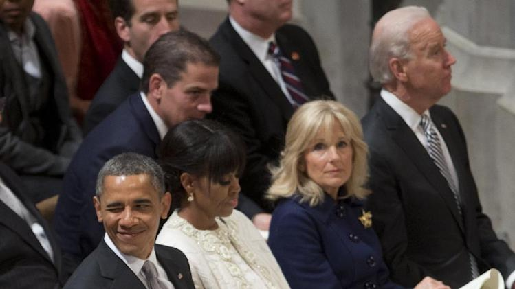 President Barack Obama winks as he, first lady Michelle Obama, Vice President Joe Biden and his wife Jill Biden attend the Presidential Inaugural Prayer Service at the Washington National Cathedral in Washington, Tuesday, Jan. 22, 2013. The 106-year-old Episcopal church has long hosted presidential inaugural services., this one following Monday's 57th Presidential Inauguration. . (AP Photo/Carolyn Kaster)