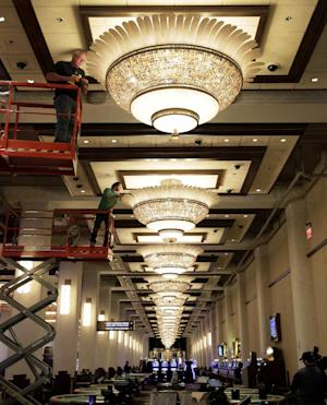Workers put the finishing touches on a gaming floor at the Horseshoe Casino Cleveland in Cleveland on Wednesday, May 9, 2012. Located in the city's old Higbee department store, the $350 million project is scheduled to open to the public on Monday, May 14. (AP Photo/Amy Sancetta)