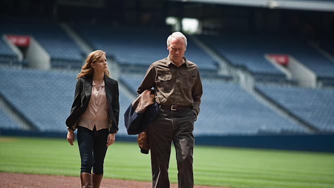 """This film image released by Warner Bros. Pictures shows Clint Eastwood, right, and Amy Adams in a scene from """"Trouble with the Curve."""" The film, about an aging and ailing baseball scout, will be released on Sept. 21. (AP Photo/Warner Bros. Pictures, Keith Bernstein)"""