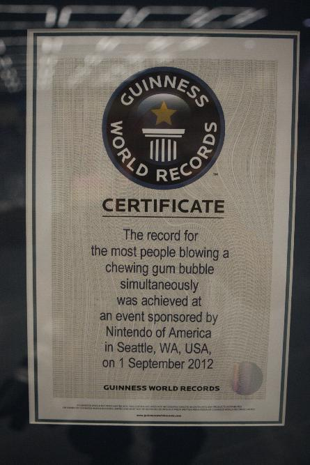 The certificate issued to Nintendo of America for the most people blowing a chewing gum bubble simultaneously at Break the World Record event with Kirby on Saturday Sept. 1, 2012 at PAX Prime in Seattle.  (Photo by Kevin Casey/Invision for Nintendo of America/AP Images)