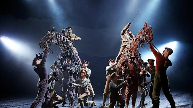 """This image released by Matt Ross Public Relations shows a performance of """"War Horse."""" Fathom Events, National Theatre Live and BY Experience will team up for a special live broadcast of the show Thursday night from London's West End. More than 300 movie theaters across America will show the broadcast, just the latest in a wave of theatrical shows that are being beamed to screens as producers seize on technological improvements and a willingness to let live shows be recorded. (AP Photo/Matt Ross Public Relations)"""