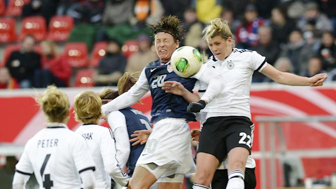 Germany's Luisa Wensing, right, and Abby Wambach of the U.S., 2nd of right, challenge for the ball during the international friendly women's soccer match between Germany and the United States in Offenbach, central Germany, on Friday, April 5, 2013. (AP Photo/Jens Meyer)