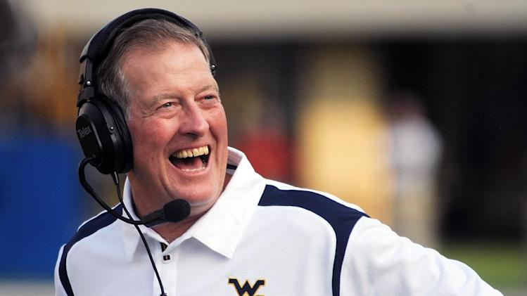 FILE - In this Aug. 30, 2008 file photo, West Virginia coach Bill Stewart smiles during an NCAA college football game against Villanova in Morgantown, W.Va. Stewart, the former West Virginia coach, died Monday, May 21, 2012, of what athletic department officials said was an apparent heart attack. A statement issued by spokesman Michael Fragale said Stewart's family notified the university on Monday. Fragale said Stewart was golfing at the time. Stewart, 59, resigned last summer and was replaced by Dana Holgorsen the same night. Stewart had gone 28-12 in three seasons after taking over for Rich Rodriguez but failed to earn a Bowl Championship Series berth. (AP Photo/Jeff Gentner, file)