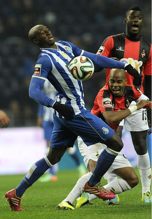 "FC Porto's Eliaquim Mangala, from France, challenges Olhanense's Pedro Celestino, centre, and Judilson ""Pele"" Gomes, right, in a Portuguese League soccer match at the Dragao Stadium"