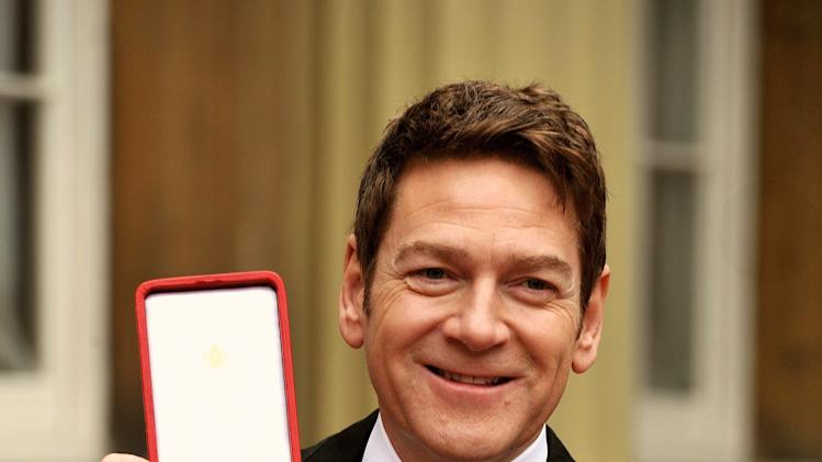 British actor Kenneth Branagh poses with his award after receiving a knighthood from Britain's Queen Elizabeth II at an investiture ceremony at Buckingham Palace, central London, Friday, Nov. 9, 2012. Belfast-born Branagh was knighted at a Buckingham Palace ceremony Friday for services to drama and for his charity work in Northern Ireland. (AP Photo/PA, John Stillwell) UNITED KINGDOM OUT, NO SALES, NO ARCHIVE