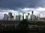 In this photo provided by Gothamist, dark clouds loom over the skyline, Saturday, Sept. 8, 2012, in New York. Two tornadoes struck New York City on Saturday, one swept out of the sea and hit a beachfront neighborhood and the second, stronger twister hit moments later, hurling debris in the air, knocking out power and startling residents who once thought of twisters as a Midwestern phenomenon. (AP Photo/Gothamist, Jake Dobkin) MANDATORY CREDIT