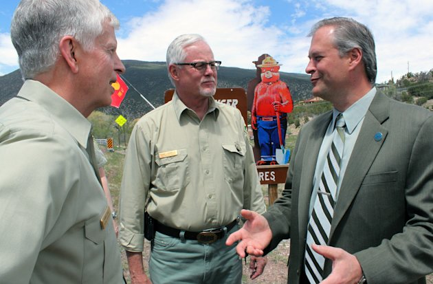 Bernalillo County Commissioner Wayne Johnson, right, talks to U.S. Forest Service Chief Tom Tidwell, left, and Regional Forester Corbin Newman, center, about wildfire response after a news conference