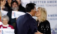 Republican presidential candidate Mitt Romney kisses his wife Ann Romney during a campaign rally April 24, in Manchester, New Hampshire. Romney effectively claimed the Republican presidential nomination, reveling in a five-state primary sweep and urging voters to help him oust President Barack Obama in November