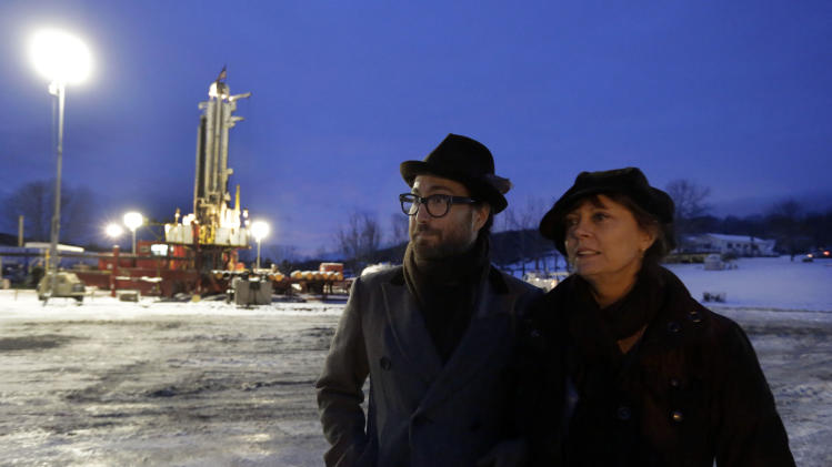 FILE - In this Jan. 17, 2013 file photo, Sean Lennon and actress Susan Sarandon visit a fracking site in New Milford, Pa. As thousands around the country mobilize for and against hydraulic fracturing, industry and some environmental groups in Illinois have come together to draft regulations both sides could live with. Some hope that cooperative approach could be a model for other states. (AP Photo/Richard Drew, File)