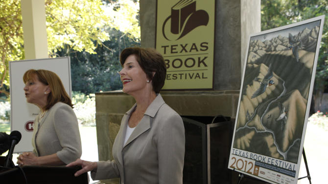 Former first lady Laura Bush, right, smiles as Lidia Agraz introduces her at the announcement of the lineup for the 2012 Texas Book festival Wednesday, Sept. 12, 2012, at Bush's home in the Preston Hollow section of Dallas.  Bush, who founded the festival when she was first lady of Texas, also unveiled this year's book festival poster for the annual event in Austin. (AP Photo/LM Otero)