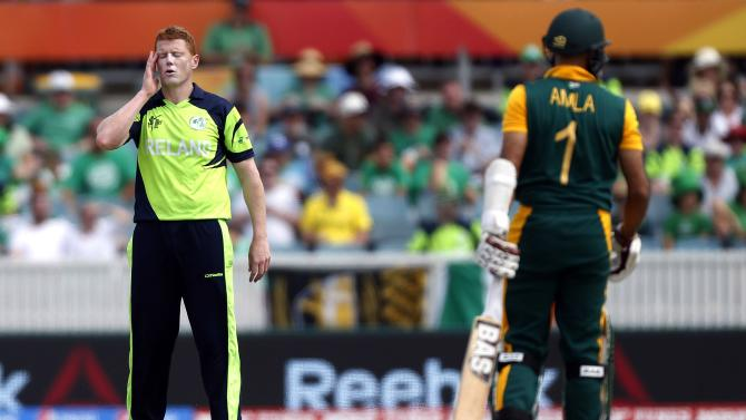 Ireland's Kevin O'Brien reacts after being hit for a boundary by South Africa's Hashim Amla during their Cricket World Cup match in Canberra