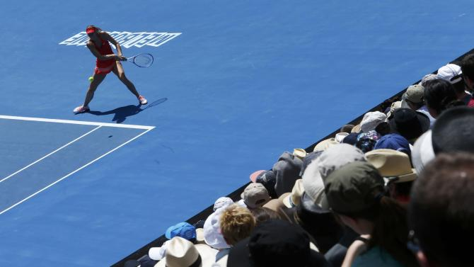 Spectators watch as Sharapova of Russia hits a return to compatriot Makarova during their women's singles semi-final match at the Australian Open 2015 tennis tournament in Melbourne