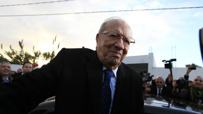 Essebsi, leader of Tunisia's secular Nidaa Tounes party and a presidential candidate, reacts after casting his vote at a polling station in Tunis