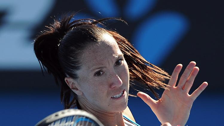 Serbia's Jelena Jankovic hits a return during her second round match against Portugal's Maria Joao Koehler at the Australian Open tennis championship in Melbourne, Australia, Wednesday, Jan. 16, 2013. (AP Photo/Andrew Brownbill)