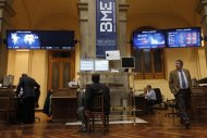 Traders look at computer screens at Madrid's bourse