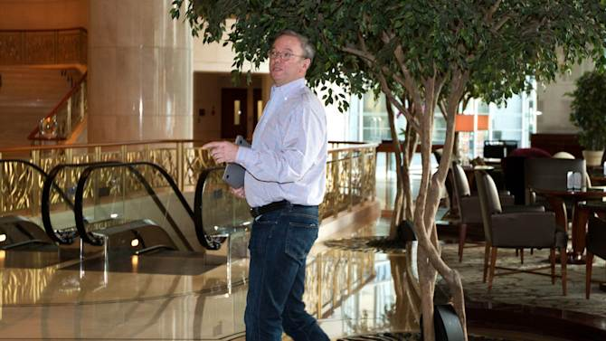 Google's executive chairman Eric Schmidt walks away from a hotel lounge after a meeting with former New Mexico Gov. Bill Richardson in Beijing Monday, Jan. 7, 2013. Schmidt, who is part of a delegation led by Richardson, is scheduled to leave Monday on a commercial flight bound for North Korea, a country considered to have the world's most restrictive Internet policies. (AP Photo/Andy Wong)