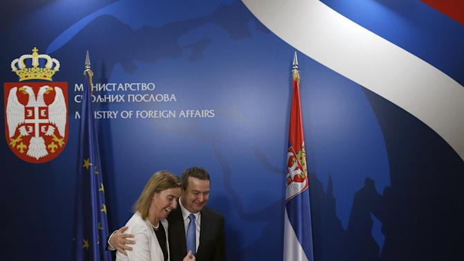 Serbian Foreign Minister Ivica Dacic, right welcomes EU High Representative for Foreign Affairs and Security Policy Federica Mogherini, during her first visit in Belgrade, Serbia, Friday, March 27, 2015. (AP Photo/Darko Vojinovic)