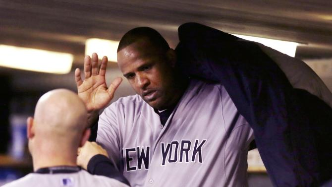New York Yankees starting pitcher CC Sabathia is greeted by catcher Brian McCann in the dugout during the eighth inning of a baseball game against the Detroit Tigers, Monday, April 20, 2015, in Detroit. (AP Photo/Carlos Osorio)