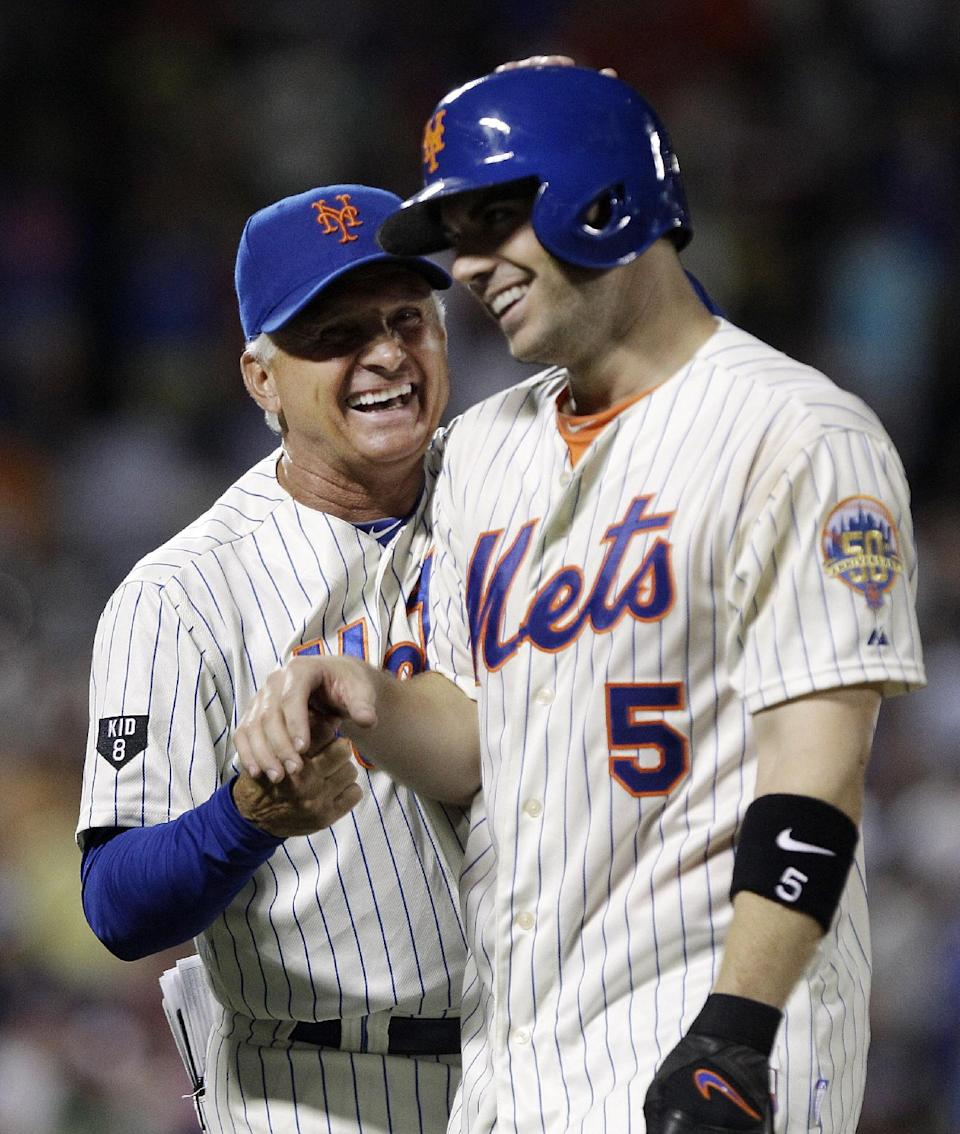 New York Mets manager Terry Collins, left, celebrates with David Wright after Wright drove in the game-winning run in the ninth inning of a baseball game against the Philadelphia Phillies, Thursday, July 5, 2012, in New York. The Mets won 6-5. (AP Photo/Frank Franklin II)