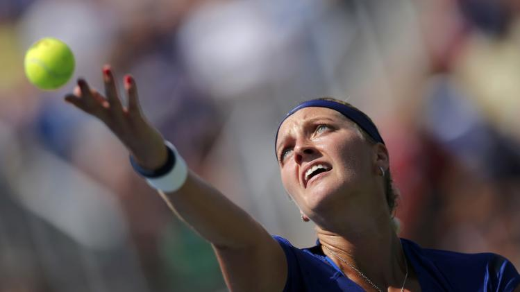 Petra Kvitova of the Czech Republic serves to Aleksandra Krunic of Serbia during their match at the 2014 U.S. Open tennis tournament in New York