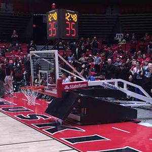 Collapsing hoop nearly injures player after monster dunk