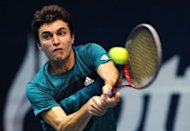 Gilles Simon of France plays a shot against Janko Tipsarevic of Serbia during their mens singles semi-final round match at the ATP PTT Thailand Open tennis tournament in Bangkok. Simon beat Tipsarevic 6-4, 6-4