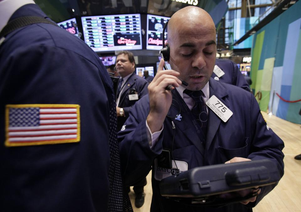 Trader Fred Demarco works on the floor of the New York Stock Exchange Wednesday, Oct. 3, 2012. Stocks are mostly higher in early trading on Wall Street Wednesday after a measure of private sector hiring came in better than economists were expecting. (AP Photo/Richard Drew)
