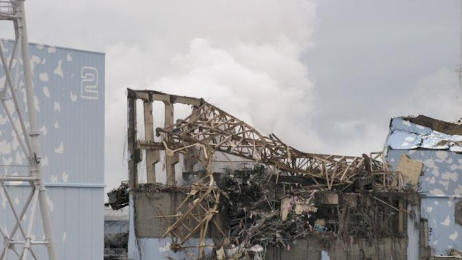 In this March 15, 2011 photo taken and provided by Tokyo Electric Power Co. (TEPCO), smoke billows from Unit 3 reactor building after an explosion at Fukushima Dai-ichi nuclear power plant in Okuma, Fukushima prefecture, following the March 11 tsunami and earthquake. The March 2011 catastrophe in Japan has set off a flurry of independent films telling the stories of regular people who became overnight victims, stories the creators feel are being ignored by mainstream media and often silenced by the authorities. Nearly two years after the quake and tsunami disaster, the films are an attempt by the creative minds of Japan's movie industry not only to confront the horrors of the worst nuclear disaster since Chernobyl, but also as a legacy and to empower the victims by telling their story for international audiences. (AP Photo/Tokyo Electric Power Co.) EDITORIAL USE ONLY