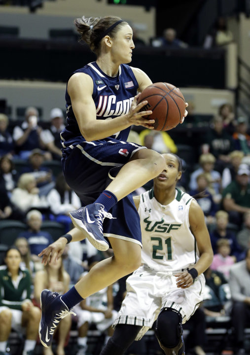 Connecticut guard Kelly Faris (34) grabs a rebound in front of South Florida guard Andrea Smith (21) during the first half of an NCAA college basketball game Saturday, March 2, 2013, in Tampa, Fla. (A