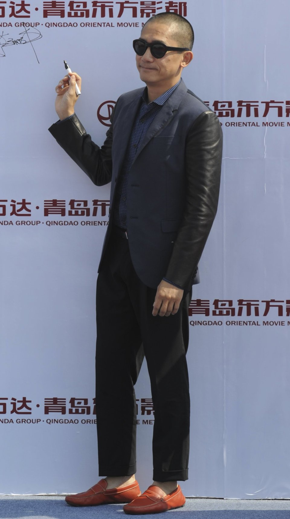 Hong Kong actor Tony Leung attends the launching ceremony of Qingdao Oriental Movie Metropolis in Qingdao in east China's Shandong province, Sunday, Sept. 22, 2013. (AP Photo)