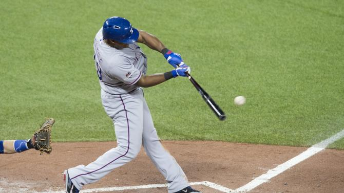 Texas Rangers' Adrian Beltre hits an RBI-single during the third inning of Game 1 of the American League Division Series baseball action against the Toronto Blue Jays in Toronto on Thursday, Oct. 8, 2015. (Darren Calabrese/The Canadian Press via AP) MANDATORY CREDIT