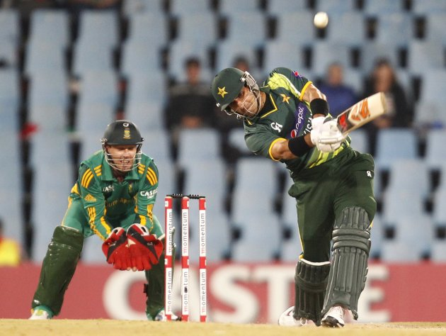 Pakistan's captain Misbah-ul-Haq plays a shot next to South Africa's wicketkeeper AB de Villiers during their second One Day International (ODI) cricket match  in Centurion