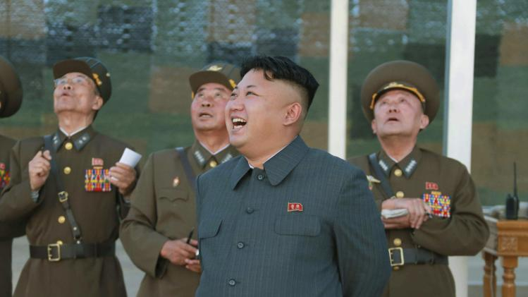 North Korean leader Kim Jong Un guides the actual parachuting and striking drill of paratrooper units of the KPA