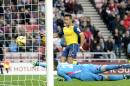 Arsenal's Alexis Sanchez scores his side's second goal of the game during their English Premier League soccer match against Sunderland at the Stadium of Light, Sunderland, England, Saturday, Oct. 25, 2014. (AP Photo/Owen Humphreys, PA Wire) UNITED KINGDOM OUT - NO SALES - NO ARCHIVES
