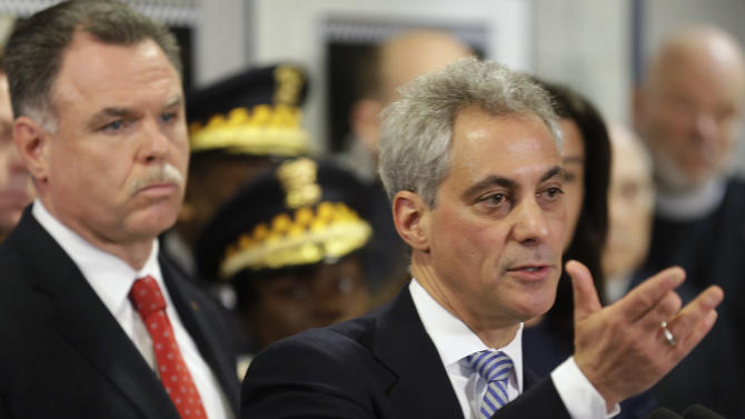 """FILE - In this Feb. 13, 2013 file photo, Chicago Mayor Rahm Emanuel, right, and Chicago Police Superintendent Garry McCarthy discuss gun violence at a news conference in Chicago.  Hundreds of Chicago police officers are hitting the streets on overtime every night in dangerous neighborhoods, the latest tactic by Emanuel's administration to reduce killings in a city dogged by its homicide rate and heartbreaking stories about honor students and small children caught in the crossfire. The decision by McCarthy last month to put small armies of officers working overtime in specific """"hot zones"""" corresponds with a notable drop in homicides in the nation's third-largest city in February and March  (AP Photo/M. Spencer Green, FIle)"""