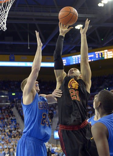 USC downs UCLA in OT 75-71