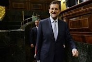 <p>Spain's Prime Minister Mariano Rajoy arrives for a parliament session in Madrid. He admits most analysts expect the country's ecpnomy to shrink both this year and next.</p>