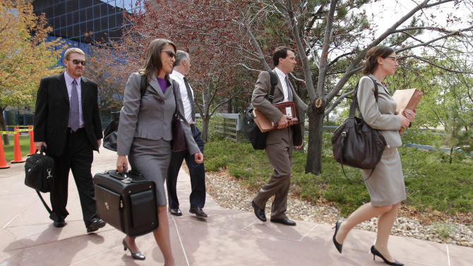 Public defenders Daniel Kink, left  and Tamara Brady, second from left walk with the defense team as they leave the Arapahoe County courthouse after a motions hearing for Aurora shooting suspect James Holmes on Thursday Aug. 9, 2012 in Centennial Colo. Holmes is charged with 12 murders the wounding of 58 others in the July 20th shooting at an Aurora theater. (AP Photo/Barry Gutierrez)