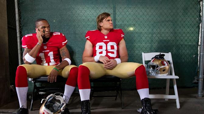 IMAGE DISTRIBUTED FOR NFLPA - San Francisco 49ers' (11) Quinton Patton and (89) Vance McDonald are sitting while waiting to be photographed at the NFLPA Rookie Premiere, on Saturday, May 18, 2013 in Pasadena, Calif. (Jeff Lewis / AP Images for NFLPA)