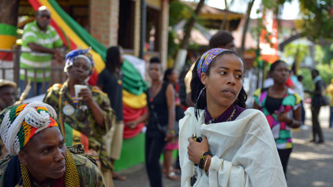 Bob Marley's granddaughter Donisha Prendergast, right, dances to reggae music during the celebration of Marley's 68th birthday at the yard of his Kingston home, in Jamaica, Wednesday, Feb. 6, 2013. Marley's relatives and old friends were joined by hundreds of tourists to dance and chant to the pounding of drums to honor the late reggae icon who died of cancer in 1981 at age 36. (AP Photo/ David McFadden)
