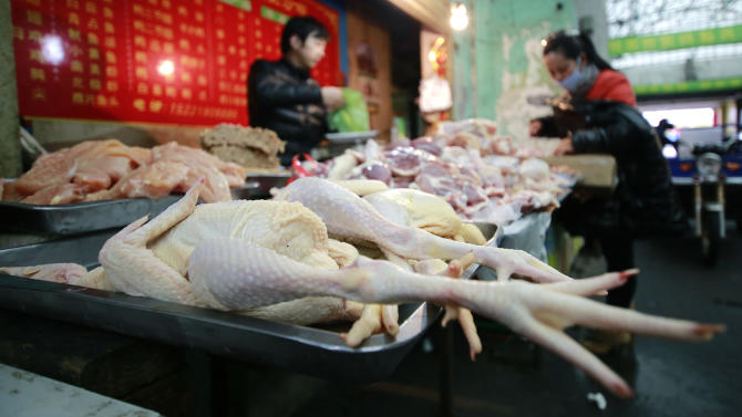 Chickens are sold at a market on Thursday, April 4, 2013, in Shanghai, China. In a worrisome sign, a bird flu in China appears to have mutated so that it can spread to other animals, raising the potential for a bigger threat to people, scientists said Wednesday. (AP Photo)