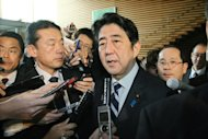 Japan&#39;s Prime Minister Shinzo Abe speaks with the press at the prime minister&#39;s official residence in Tokyo on February 12, 2012. Abe will hold talks with US President Barack Obama in Washington on February 22, with North Korea high on the agenda, the top government spokesman said Friday
