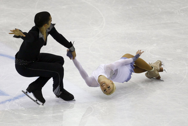 Aliona Savchenko and Robin Szolkowy of Germany perform during their Pairs Short program at the ISU 2012 World Figure Skating Championships in Nice, southern France, Wednesday, March 28, 2012. (AP Photo/ Francois Mori)