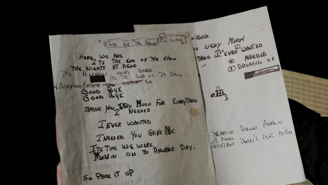 Hand written lyrics by Dennis Wilson for a song called 'End of the Show' is displayed in London, Thursday, April 18, 2013. A large archive collection of The Beach Boys early compositions, contracts, publishing agreements, hand written songs and hand written musical manuscripts will be auctioned this month in one lot. The archive is being auctioned by closed bidding by The Fame Bureau in London, bids are accepted up to May 15. (AP Photo/Kirsty Wigglesworth)