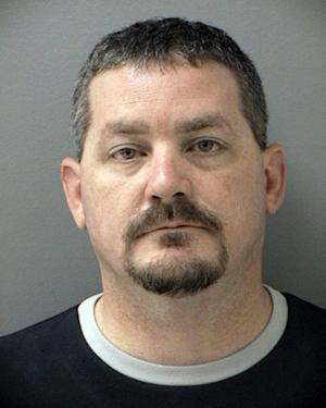 This photo provided by the Cherokee County Sheriff's Office shows Shane Ladner, 40, of Canton, Ga., who was arrested Wednesday, June 12, 2013 and charged with four counts of theft by deception, false swearing and giving a false statement to police. Authorities say the ex-police officer from Georgia who was injured in a train accident during a veterans parade in Texas lied about receiving a Purple Heart medal. (AP Photo/Cherokee County Sheriff's Office)