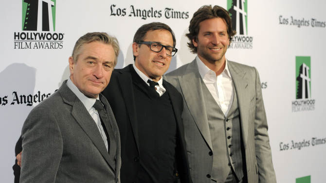 """Robert De Niro, left, recipient of the Hollywood Supporting Actor Award, David O. Russell, center, recipient of the Hollywood Director Award, and Bradley Cooper, recipient of the Hollywood Actor Award, pose together at the 16th Annual Hollywood Film Awards Gala on Monday, Oct. 22, 2012, in Beverly Hills, Calif. Russell directed De Niro and Cooper in the forthcoming film """"Silver Linings Playbook."""" (Photo by Chris Pizzello/Invision/AP)"""
