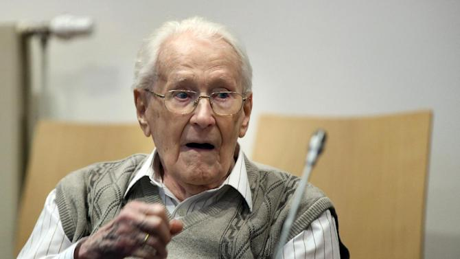 Defendant Oskar Groening waits at court for the opening of his trial Tuesday, April 21, 2015 in Lueneburg, northern Germany.  The  93-year-old former Auschwitz guard faces trial on 300,000 counts of accessory to murder, in a case that will test the argument that anyone who served at a Nazi death camp was complicit in what happened there.    (Ronny Hartmann/Pool Photo via AP)