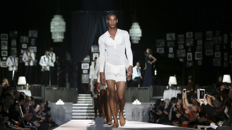 Models wear creations for DSquared2 men's Fall-Winter 2013-14 collection, part of the Milan Fashion Week, unveiled in Milan, Italy, Tuesday, Jan. 15, 2013. (AP Photo/Antonio Calanni)